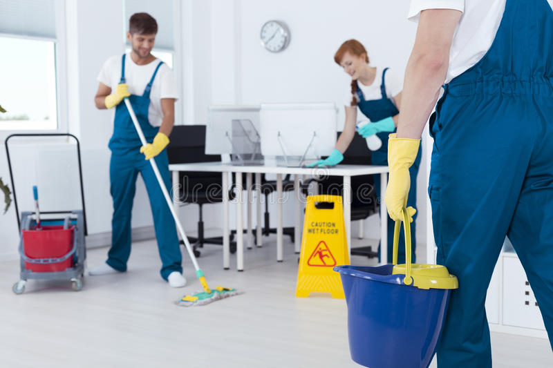Busy professional cleaners royalty free stock image