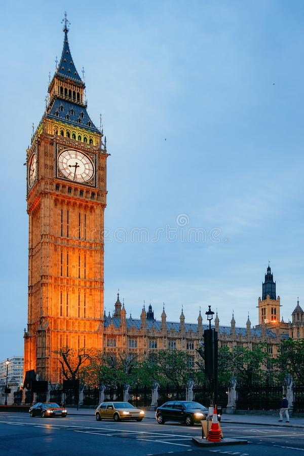 Busy road at Big Ben of Westminster Palace in London. Car traffic on busy road at Big Ben of Westminster Palace in London old town in United Kingdom in evening royalty free stock image