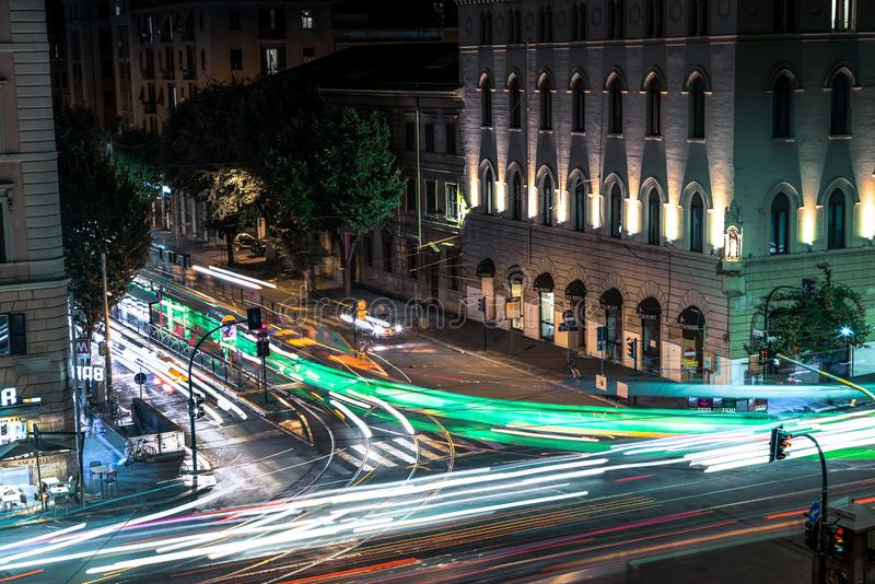 Busy Rome street with tram rides at night with light trail. Long exposure photo royalty free stock images