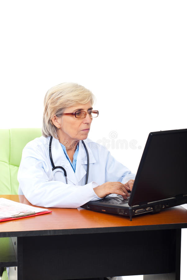 Busy senior woman doctor in office