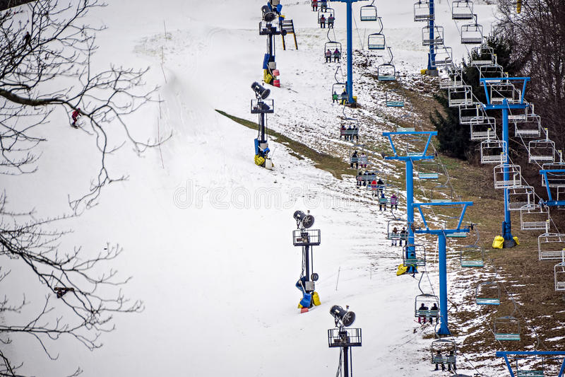 Busy skiing season at a winter place ski resort stock image