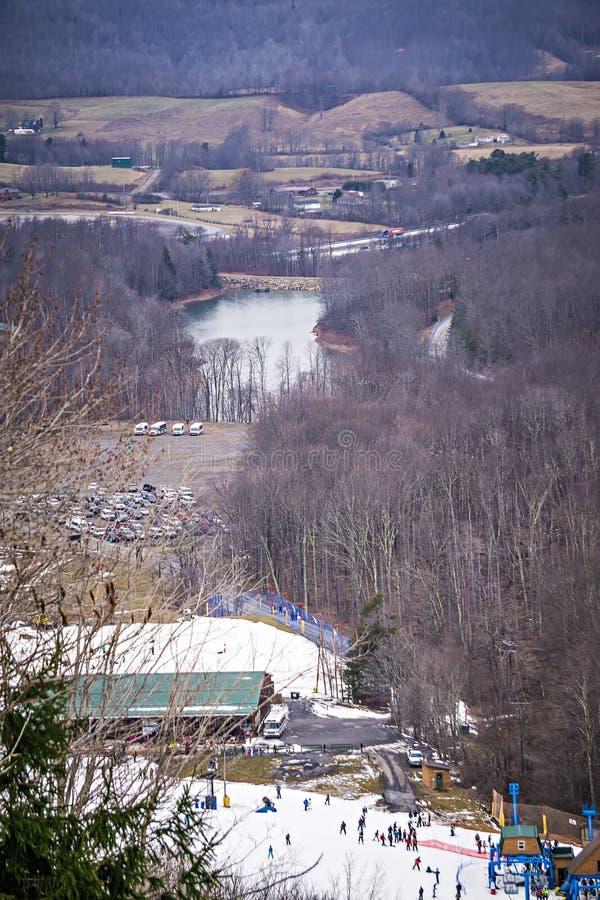 Busy skiing season at a winter place ski resort royalty free stock photography
