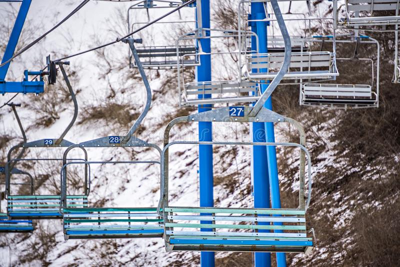Busy skiing season at a winter place ski resort royalty free stock images