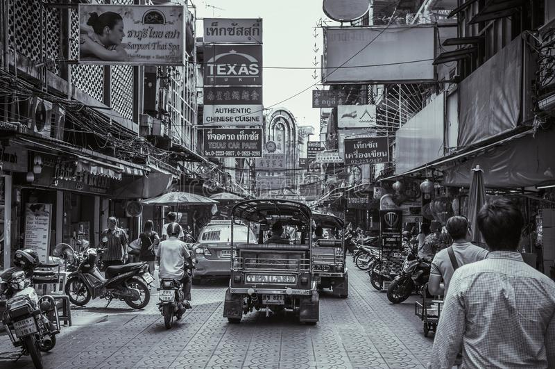 Busy street of Bangkok China town - Yaowarat with Tuk Tuk car stock images