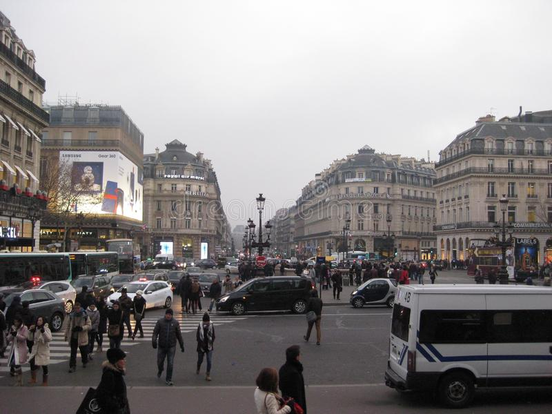 A busy street front outside the Palais Garnier, Paris royalty free stock photography