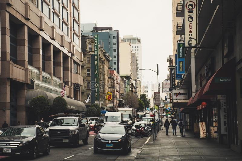 Busy Street With Vehicles and People Walking Beside Buildings royalty free stock images