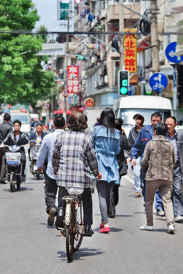 Busy streetlife on a summerday in Shanghai, China royalty free stock photography
