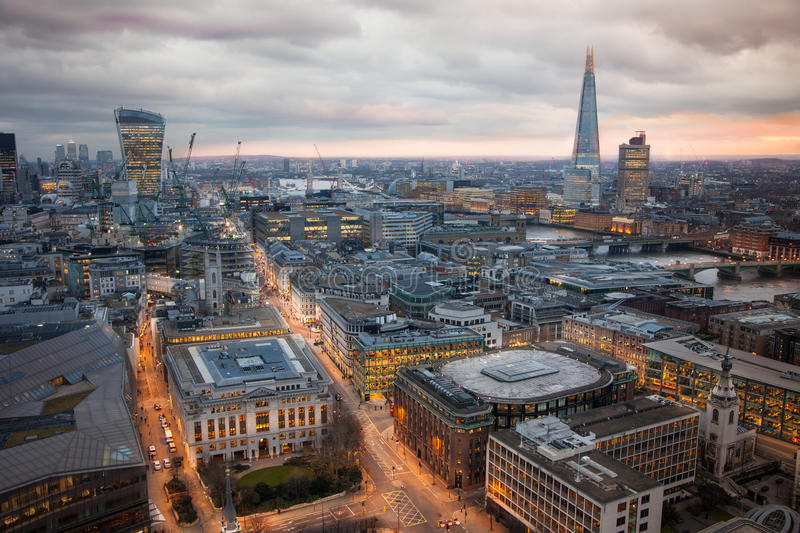 Busy streets of City of London in the dusk. First evening lights and sunset. London's panorama from the St. Paul cathedral. LONDON, UK - JANUARY 27, 2015: Busy royalty free stock image
