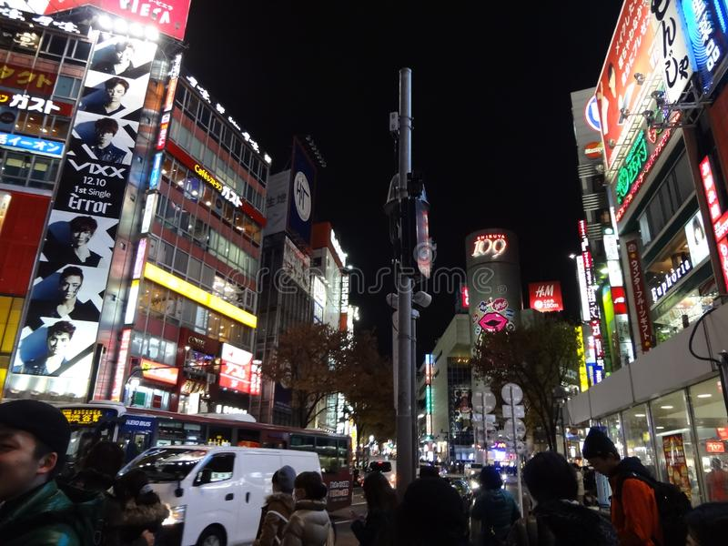 Shibuya at night. Busy streets in Shibuya at night, neon signs and Shibuya 109 in the background, christmas shopping; December 2014 royalty free stock photo