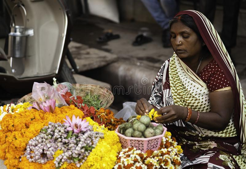 Woman Making Flower Garlands at Her Stall royalty free stock photography