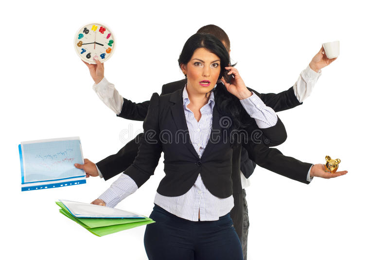 Busy stressed business woman. Busy business people holding different objects and a shocked businesswoman talking by phone mobile in front of them isolated on royalty free stock image