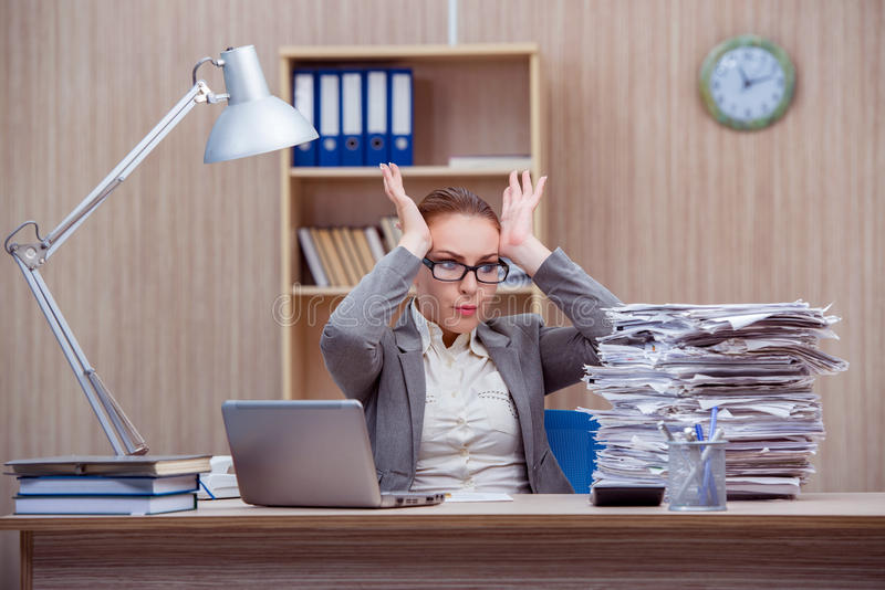 The busy stressful woman secretary under stress in the office royalty free stock images
