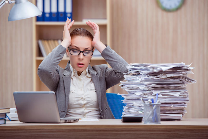 The busy stressful woman secretary under stress in the office stock photos