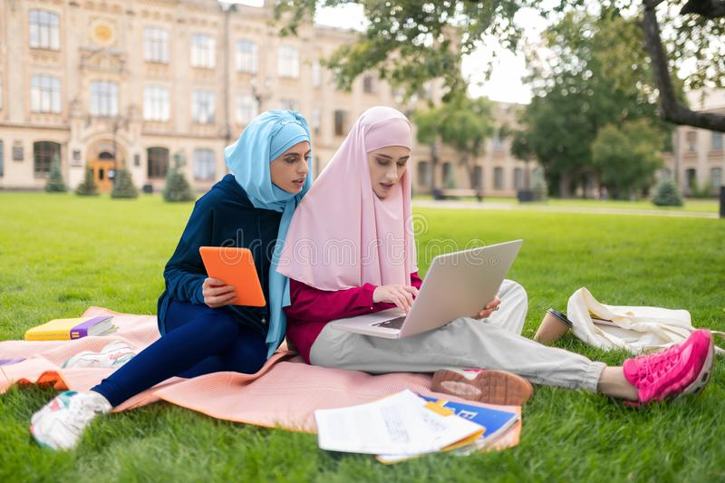 Busy students feeling overloaded having too much homework royalty free stock photography