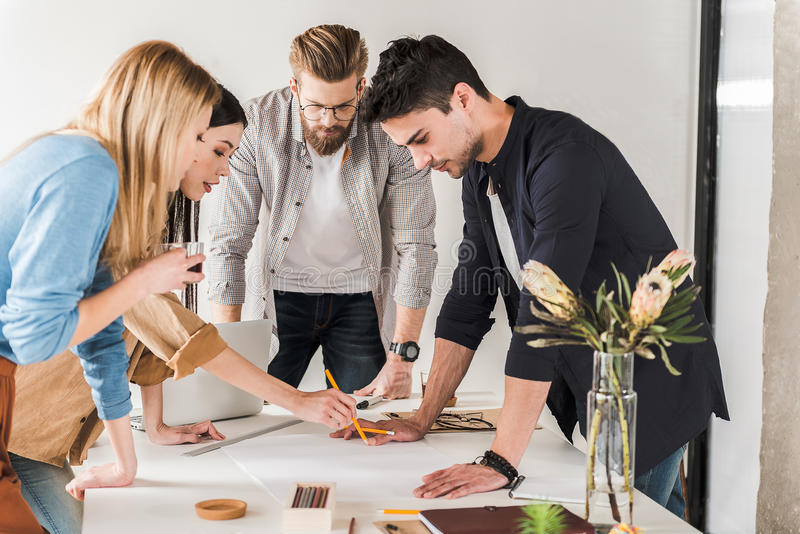 Busy team working together in office royalty free stock images