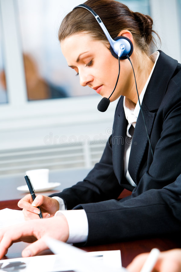 Busy telephone operator stock photo