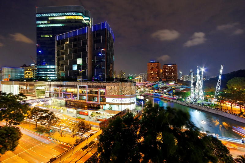 Busy and urban night life along Singapore River stock photos