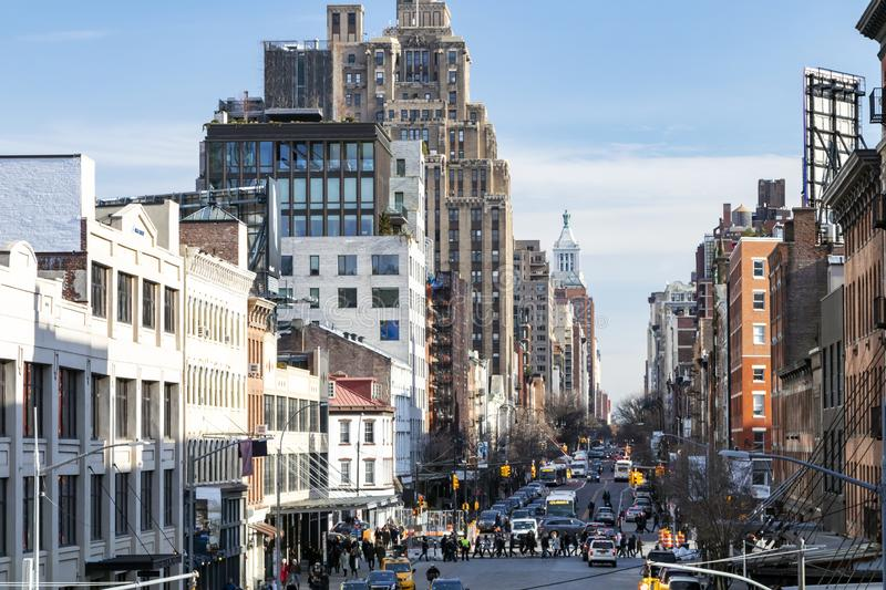 Busy view of 14th Street with crowds of people scene from the Highline Park New York City royalty free stock photos