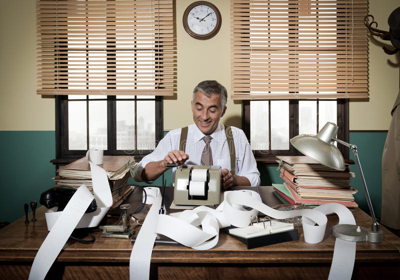 Busy vintage accountant with calculator stock image