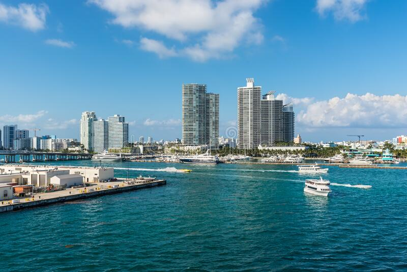 The busy water boat traffic at marina Meloy Channel, Miami, Florida, United States of America. Miami, FL, United States - April 28, 2019: Luxury high-rise stock images