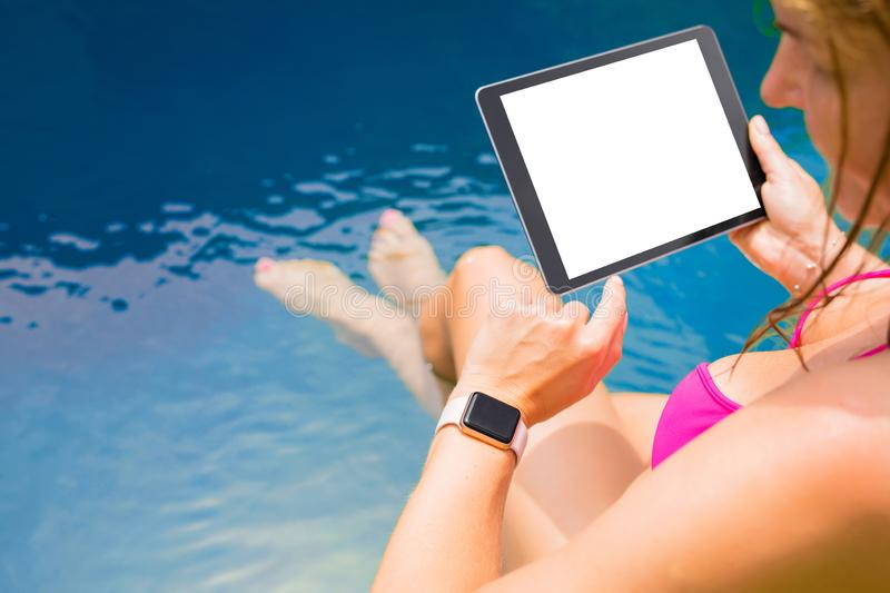 Woman using smartwatch and tablet computer. Busy woman using smartwatch and tablet computer stock photos