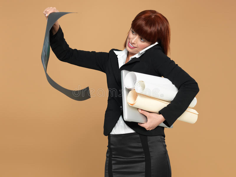 Busy, women holding laptop, papers, telephone royalty free stock photos