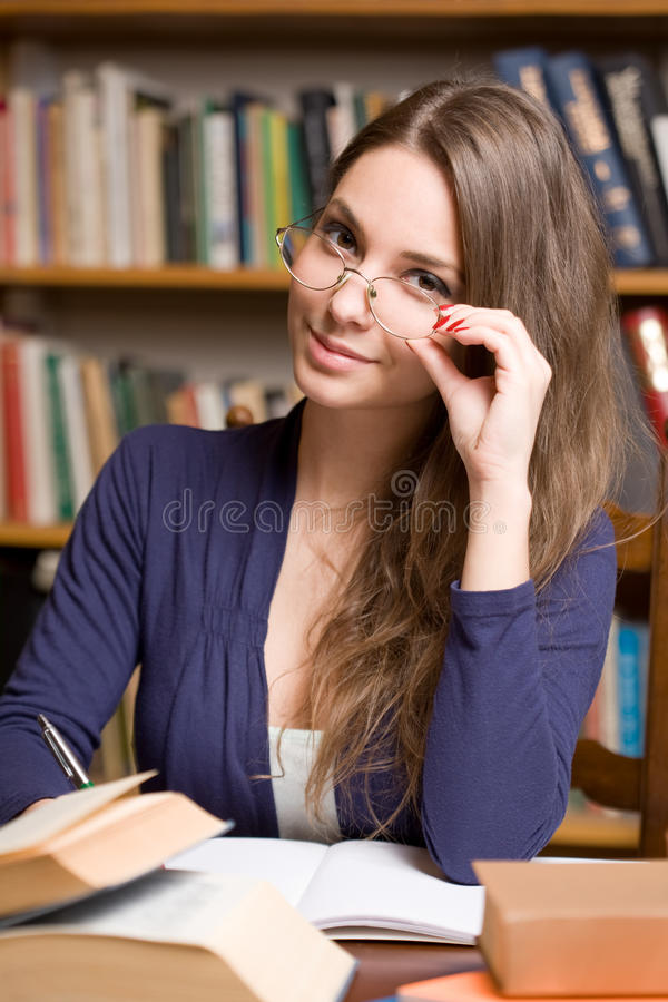 Busy young brunette student stock photography