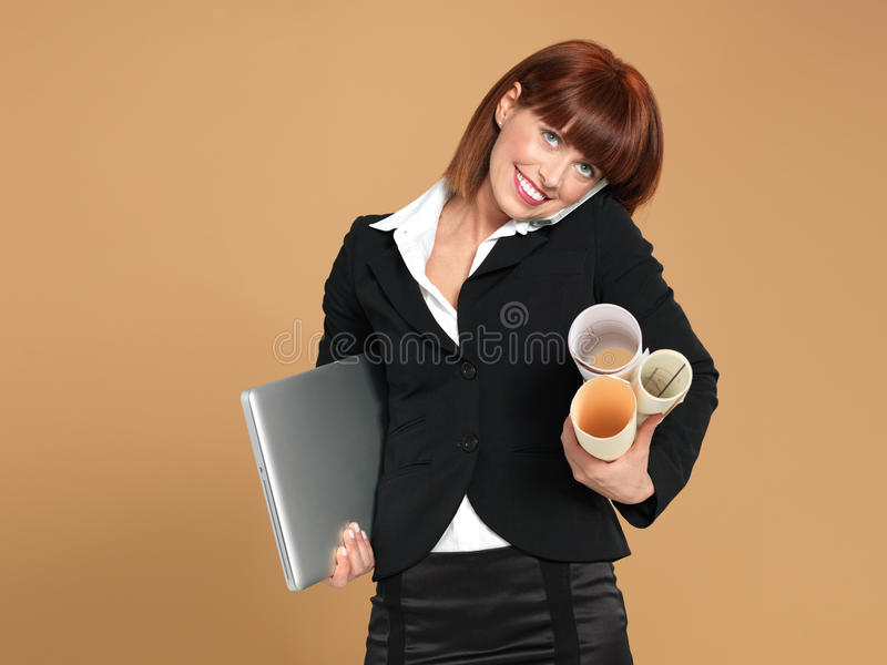 Busy, young holding laptop, papers, telephone stock photos