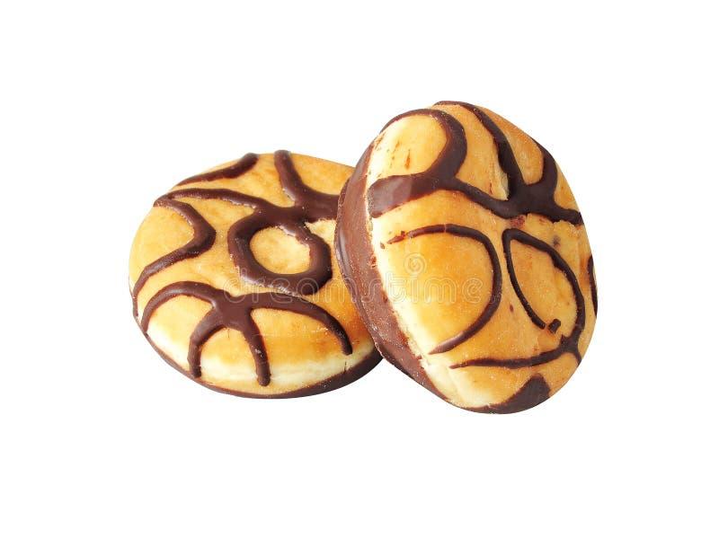 Butées toriques avec des bandes de chocolat d'isolement sur un fond blanc D oughnut avec le remplissage de chocolat Berlina de xo photo libre de droits