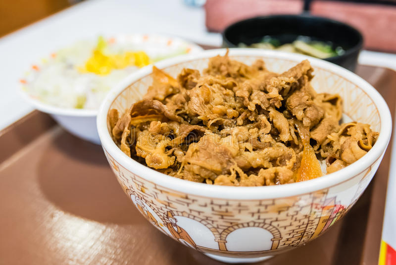 Buta-don. Japanese style Fried Pork with sweet sauce on top of rice bowl serve with soup and salad royalty free stock photo