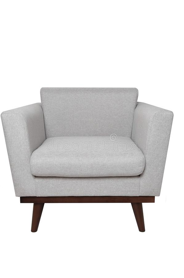 Butaca gris brillante moderna de la tela con las piernas de madera aisladas en el fondo blanco Muebles estrictos del estilo imágenes de archivo libres de regalías