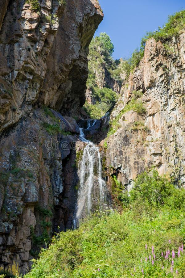 Butakovsky waterfall in the mountains of the city of Almaty, Kazakhstan. Summer in the mountains. Butakovsky waterfall in the mountains of the city of Almaty stock photography