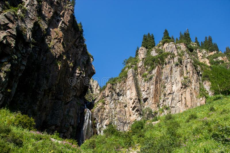 Butakovsky waterfall in the mountains of the city of Almaty, Kazakhstan. Summer in the mountains. Butakovsky waterfall in the mountains of the city of Almaty royalty free stock image