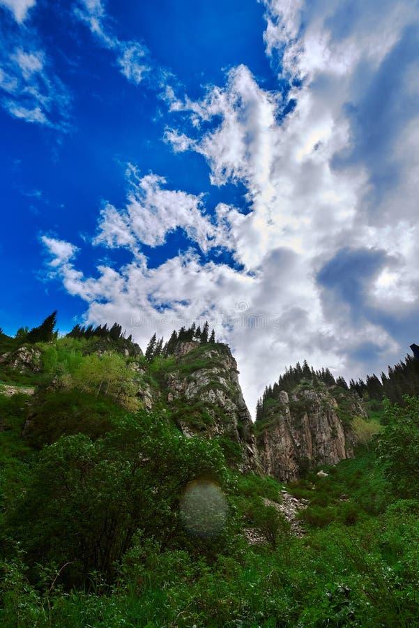 Butakovsky waterfall with sky and cloud. Near Almaty, landscape nature stone sky royalty free stock photo