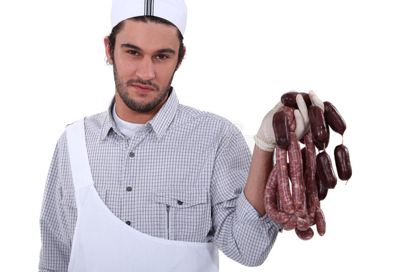 Butcher Holding Sausages Stock Image