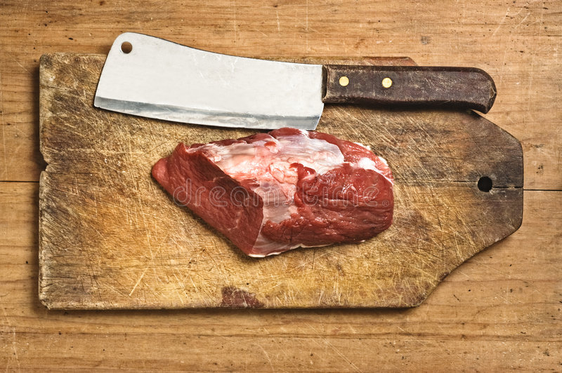 Butcher kife and raw meat stock photos
