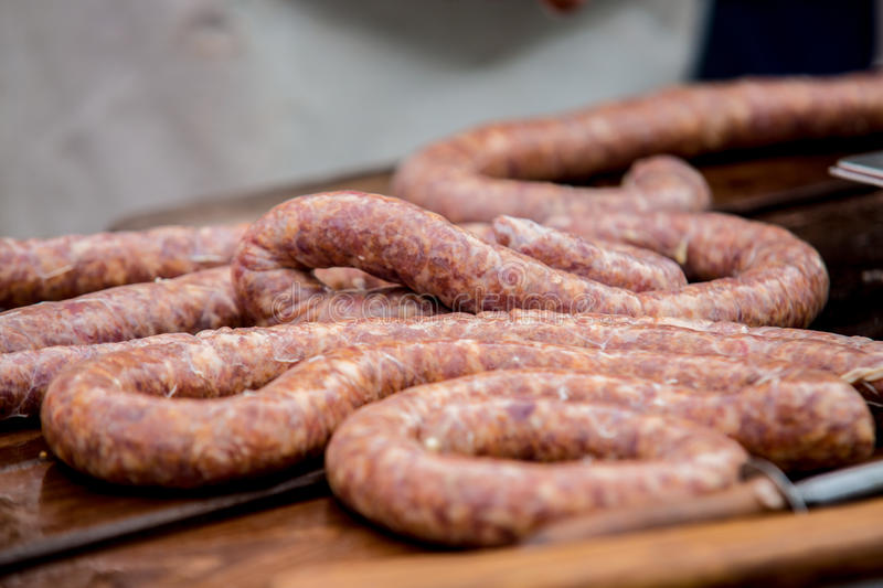Butcher making sausages in meat factory stock images