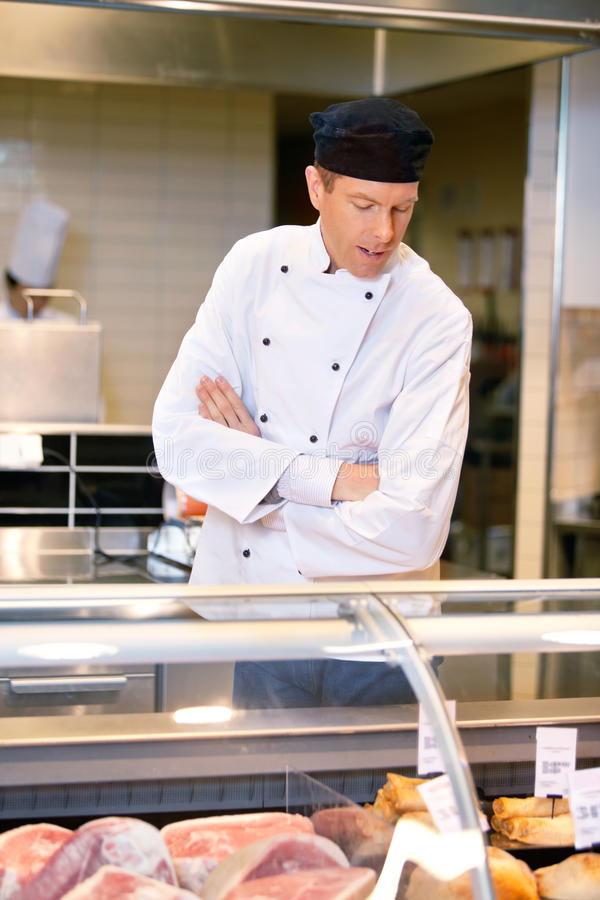 Butcher at Meat Counter royalty free stock photo