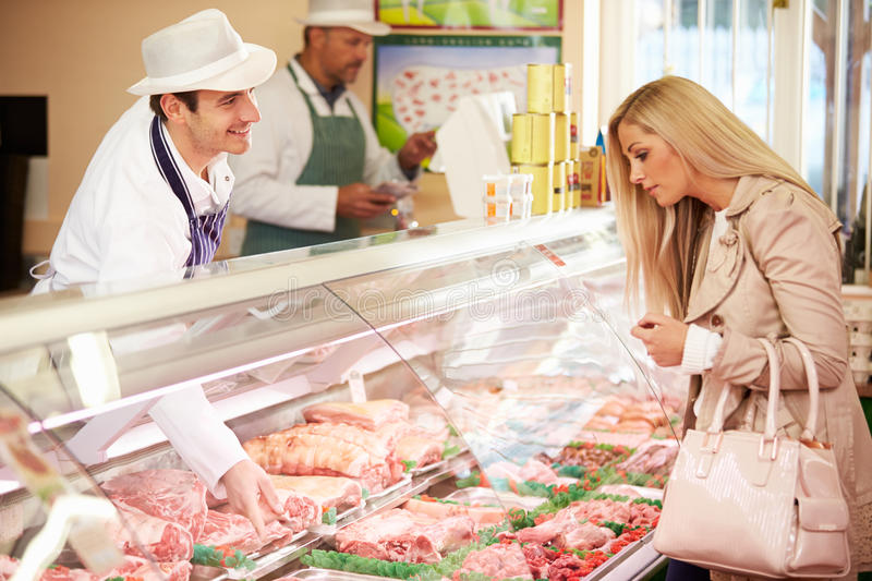 Download Butcher Serving Customer In Shop Stock Photo - Image: 36604584