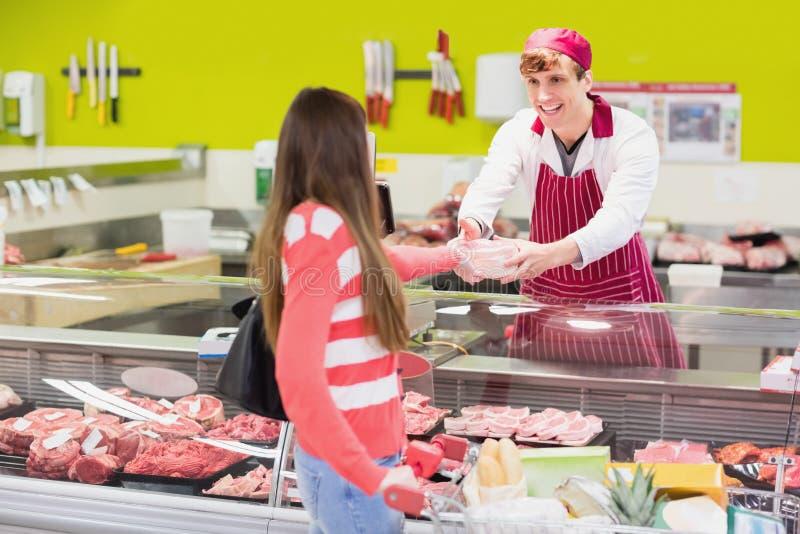 A butcher serving his customer royalty free stock photos