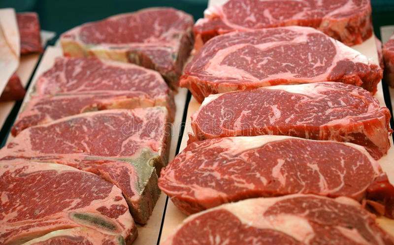 Butcher shop beef steaks stock images