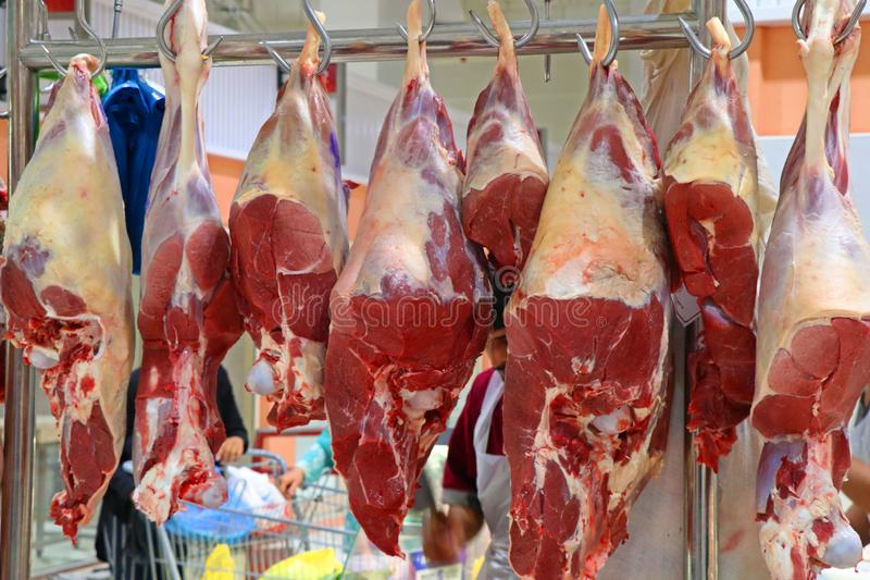 Butcher shop with hanged meats stock photos