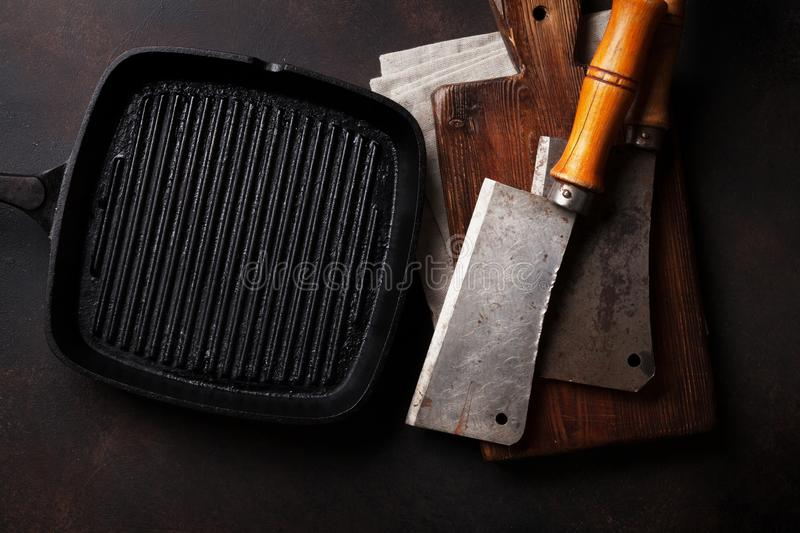 Butcher. Vintage meat knives and frying pan royalty free stock images