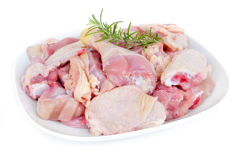 Butchered chicken. A plate with the different pieces of a butchered chicken on a white background stock photo
