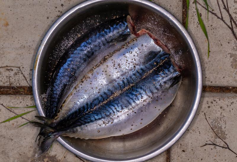 Butchered fish. The cooking process. Country kitchen. Mackerel royalty free stock photography