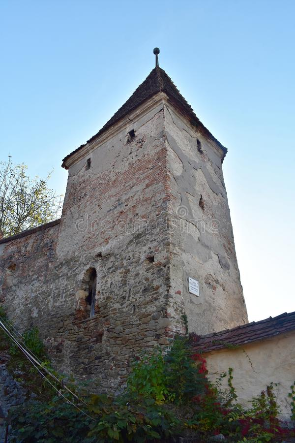 The Butchers` Tower, Turnul Macelarilor, historical tower in the medieval citadel of Sighisoara. The Butchers` Tower, is one of the nine towers located in the stock image