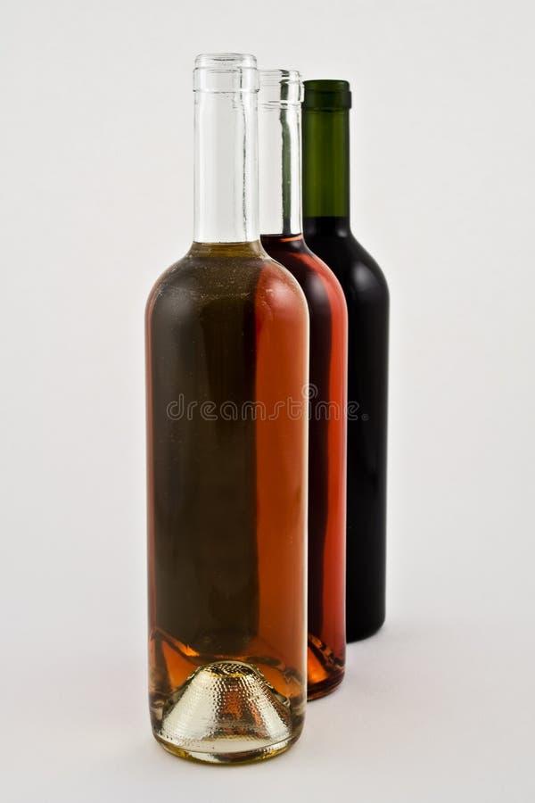 butelek czerwieni róży biały wino obraz royalty free