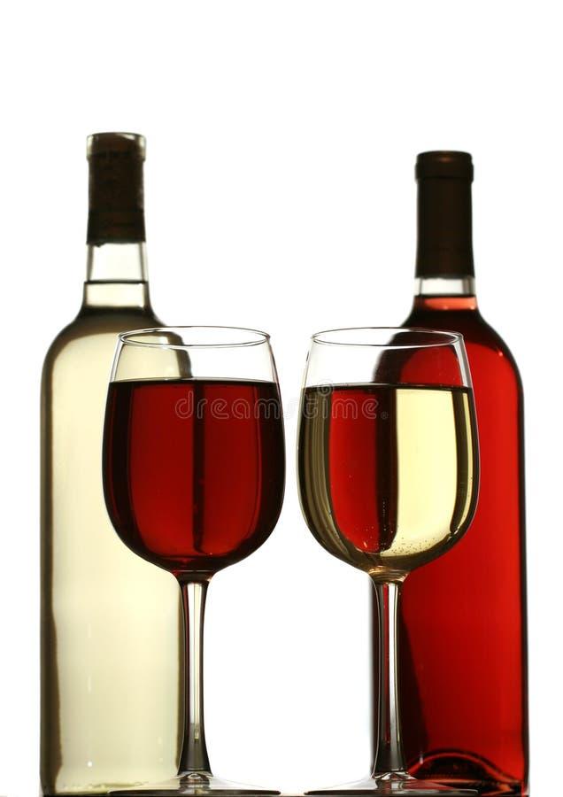 butelek okularów za czerwonym białe wino obrazy stock