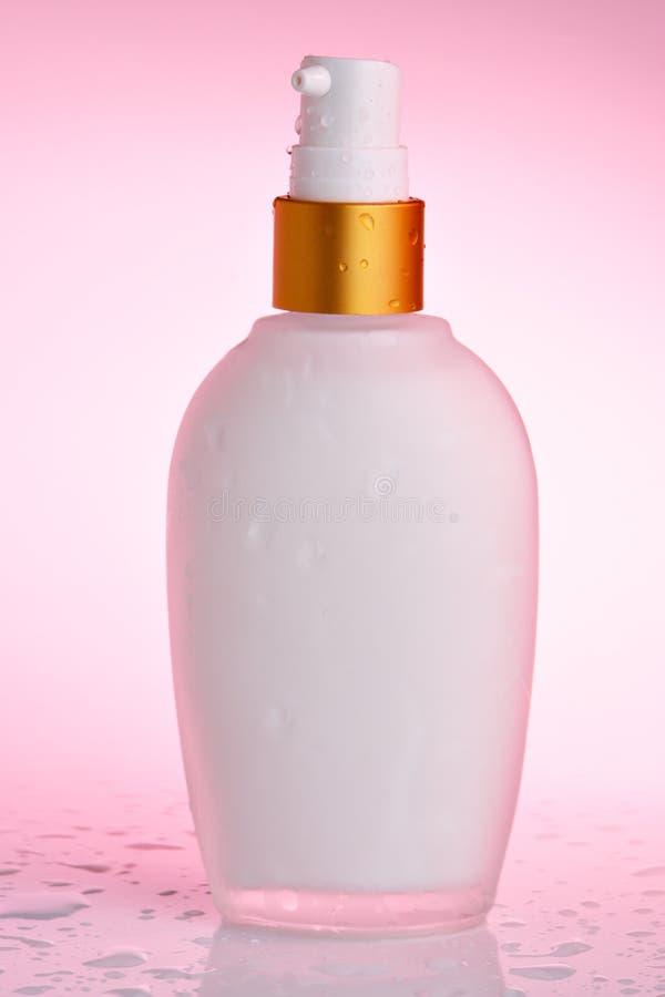 butelka śmietany kosmetycznym obraz royalty free