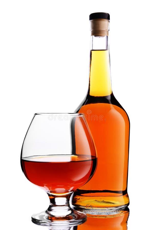 Butelka i szkło koniak fotografia stock